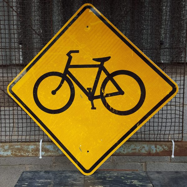 Black Bicycle Yellow Road Sign