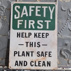 Safety First Metal Sign