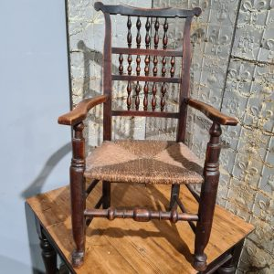 An Elm and Beech Spindle Back Armchair