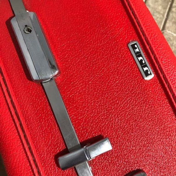 American Tourister Red Suitcase